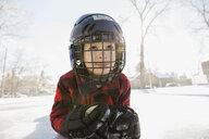 Boy lying on ice hockey rink - HEROF01859