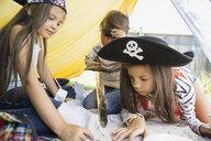 Children playing pirates and viewing treasure map - HEROF02000