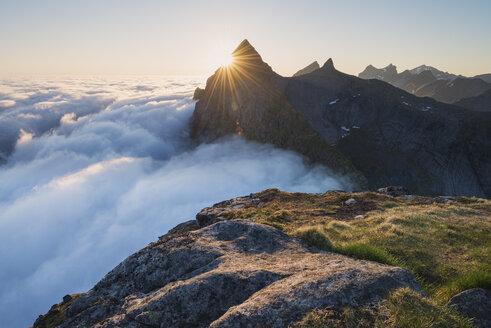 Helvetestind peak above fog, Moskenesoya, Lofoten Islands, Norway - AURF07931