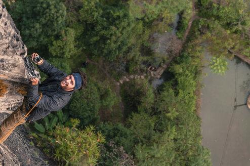 Man rock climbing, Yangshuo, Guangxi Province, China - AURF07943
