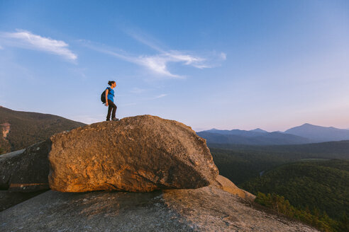 Female hiker standing on boulder, Pitchoff Mountain, Adirondack Mountains, New York State, USA - AURF07952