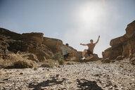 Namibia, Namib desert, Namib-Naukluft National Park, Sossusvlei, two men jumping in Sesriem Canyon - LHPF00230