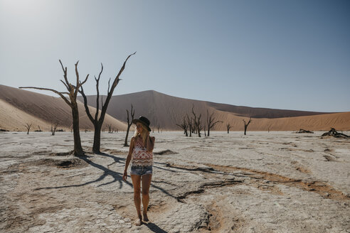 Namibia, Namib desert, Namib-Naukluft National Park, Sossusvlei, woman walking in Deadvlei - LHPF00251