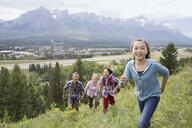Family playing on rural hillside - HEROF02089
