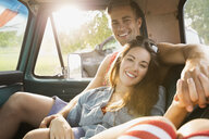 Couple relaxing together in truck - HEROF02134