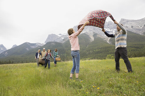 Family having picnic in rural field - HEROF02170