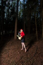 Full length shot of a girl posing in the forest - INGF11292