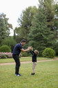 Father and son playing together in park - MAUF02069