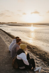 Namibia, Walvis Bay, three friends relaxing at sunset - LHPF00286