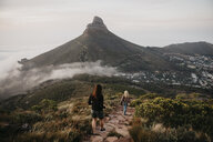 South Africa, Cape Town, Kloof Nek, two women on a trail at sunset - LHPF00307