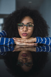 Portrait of young woman wearing glasses - KKAF03094