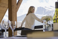 Portrait of woman on balcony with mountain view - HEROF02306