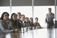 Businessman leading meeting in conference room - HEROF02477