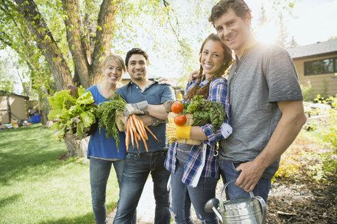 Portrait of holding carrying freshly harvested vegetables - HEROF02822