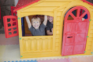 Portrait of happy children in a playhouse - ZEF16069