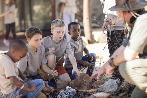 Children learning how to make a fire - ZEF16075