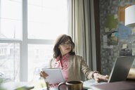 Woman working at laptop in home office - HEROF03065