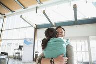 Smiling couple hugging in airport - HEROF03233
