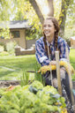 Smiling woman in vegetable garden - HEROF03254