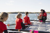 Coach talking to rowing team in scull - HEROF03344