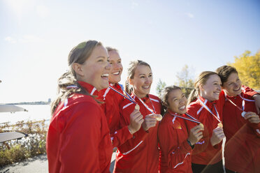 Rowing team with medals celebrating - HEROF03347