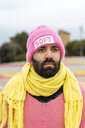 Portrait of bearded gay with nose piercing wearing pink cap with the word 'soft' - AFVF02175