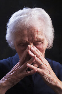 Portrait of an aged woman, looking sad - WWF04569