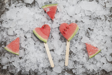 Watermelon heart ice lollies on crashed ice - GWF05740