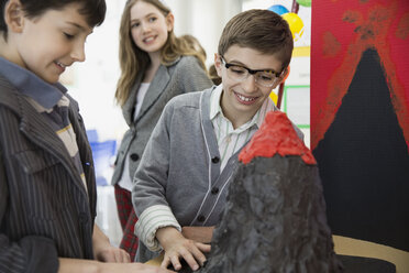 School boy explaining science fair project to classmates - HEROF03534