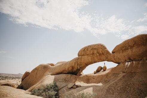 Namibia, Spitzkoppe, man standing on boulder at rock formation - LHPF00348