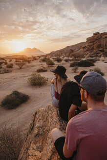 Namibia, Spitzkoppe, friends sitting on a rock watching the sunset - LHPF00372