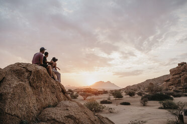 Namibia, Spitzkoppe, friends sitting on a rock watching the sunset - LHPF00378