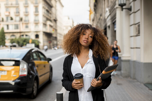 Young woman with laptop bag and coffee to go in the city, missing the taxi - MAUF02133
