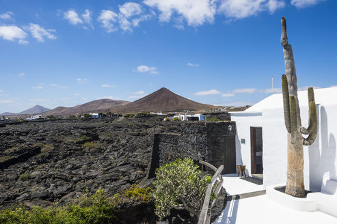 Spain, Canary Islands, Lanzarote, volcanic landscape with Foundation Cesar Manrique in the foreground - RUN00598