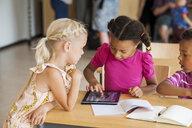 Children using digital tablet in classroom - ASTF00031