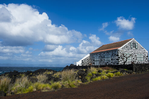 Portugal, Azores, Island of Pico, painted lava stone house in Lajido - RUNF00641