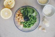 Ingredients for peas hummus, chickpeas, lemon, coriander, garlic, sesame and salt in blender - MBEF01461