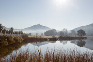 Scenic reflective view of a lake in the sun - INGF12068