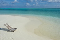 Maledives, Ari Atoll, Nalaguraidhoo, Sun Island, empty deckchair at seaside - RUNF00720