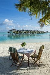Maledives, Ari Atoll, Nalaguraidhoo, Sun Island Resort, laid table on the beach - RUNF00723