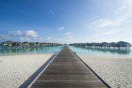 Maledives, Ari Atoll, Nalaguraidhoo, Sun Island Resort, pier to bungalows - RUNF00726