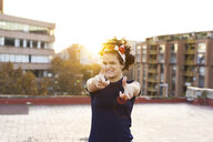 Portrait of young woman having fun in the city at sunset - ERRF00435