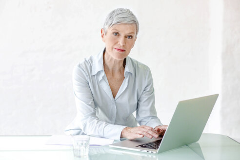 Portrait of mature businesswoman working on laptop - VWF00025