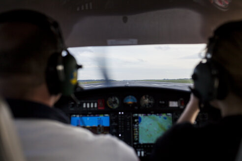 Rear view of pilots in cockpit - ASTF00367