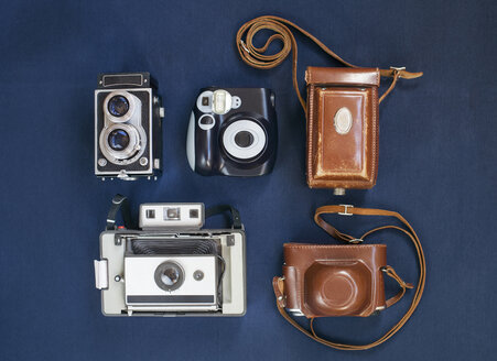 Top view of antique cameras on blue table - ASTF00448