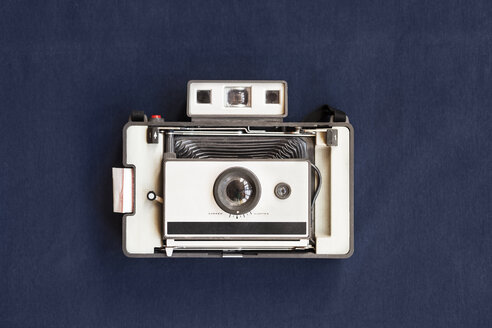 Top view of old instant camera on blue table - ASTF00451