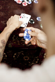 Cropped image of man playing poker at home - ASTF00784