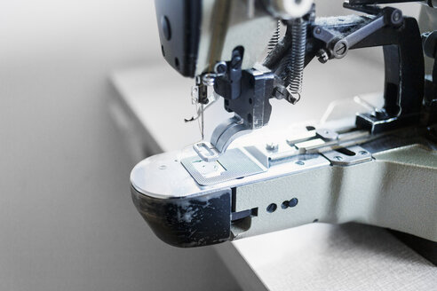 Close-up of sewing machine in jeans factory - ASTF00973