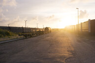 Railroad tracks by road against sky - ASTF01075