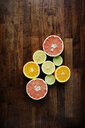 Directly above shot of sliced citrus fruits on chopping board - ASTF01081